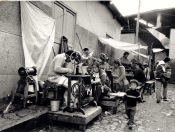 Cobblers working in a Lima market  / TAFOS, Peru, 1989